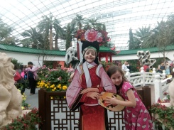 madeline and Ginny pose flower dome